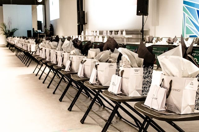 Gift bags lined up for promotional product giveaway