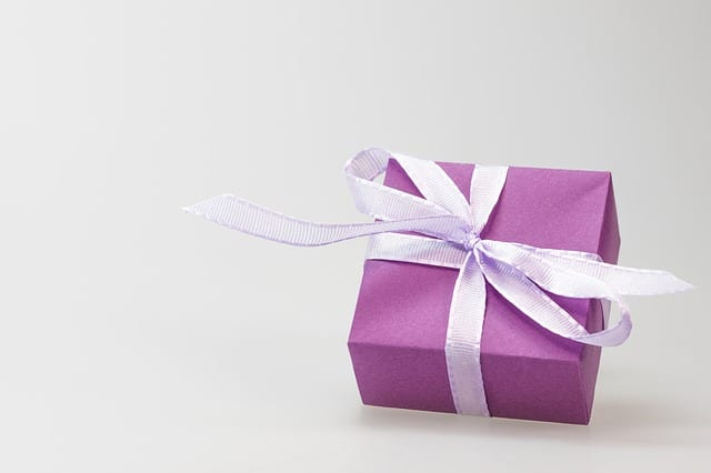 Purple gift box given as thanks for referral