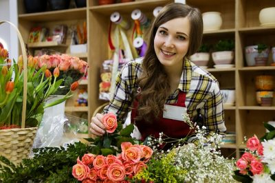 Smiling Clerk in a Flower Shop