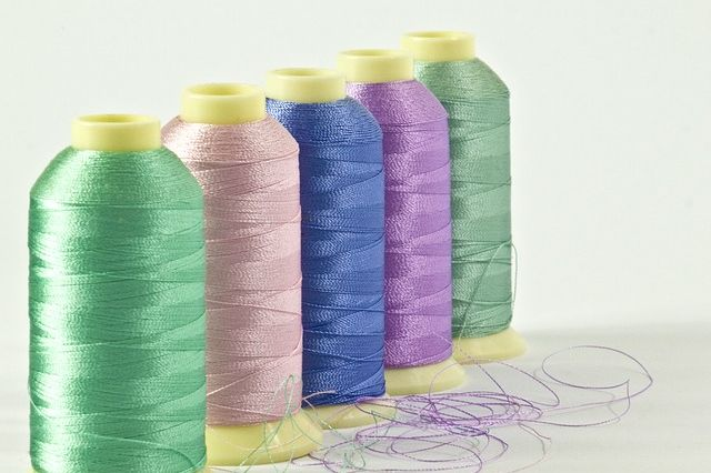 Pastel toned embroidery thread shuttles