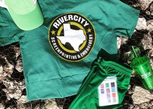 Green shirts, shorts, cups, and hats with RiverCity branding for St. Patrick's Day