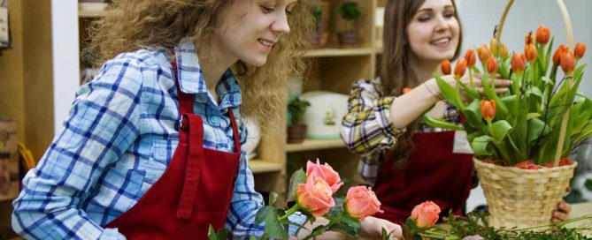 Employees in uniforms at a flower shop