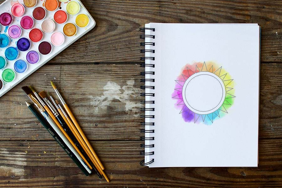 Watercolor supplies and a color wheel