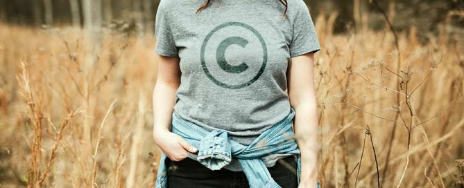 Woman wearing a t-shirt with a copyright symbol