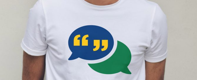 Man modeling a t-shirt with a speech bubble illustrating terminology