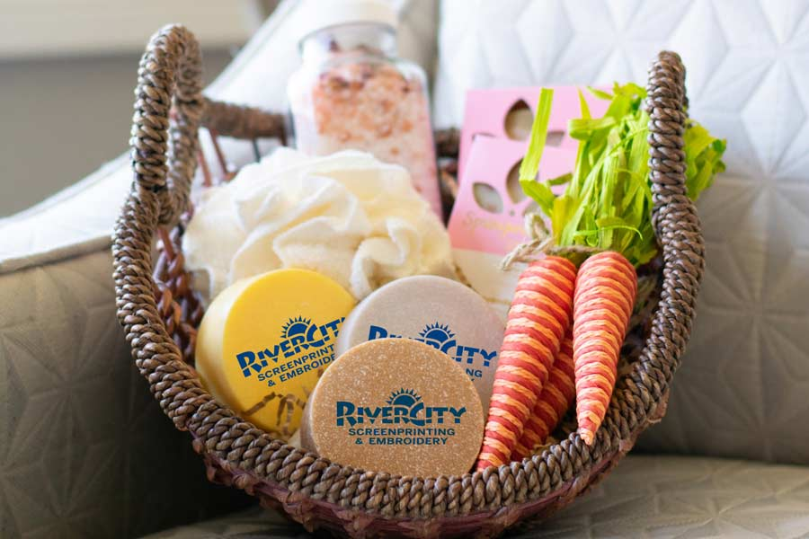 A gift basket with branded soaps and other bath products